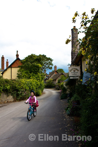 A young girls bicycles by Kitnor's Tea Room & Gardens in Bossington, Exmoor National Park, Somerset. England, U.K.