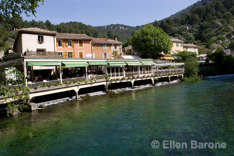 Outdoor cafes line the River Sorgue at Fontaine de Vaucluse, Provence, France, Europe