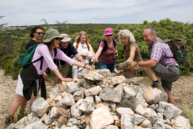 Wayfarers walkers add stones to a cairn, near Fontain de Vaucluse, Provence, France, Europe