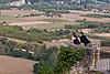 Tourists take in the panoramic view of the Dordogne River valley, Domme, France.