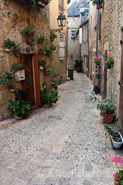 Winding medieval village street, Sarlat, France.