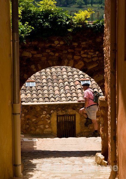 Wayfarers guide in the beautiful multi-hued village of Roussillon, the Luberon, Provence, France, Europe.