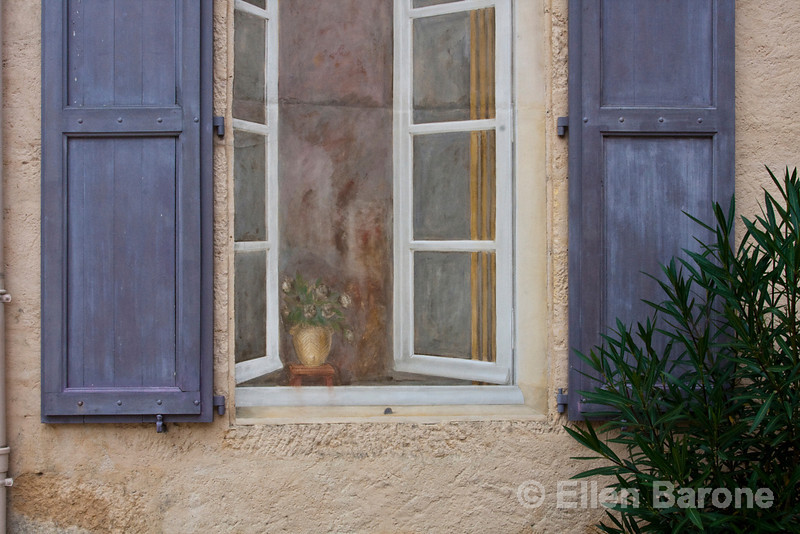 Shuttered window and art mural, Chateau Marquayssac, Dordogne, France.