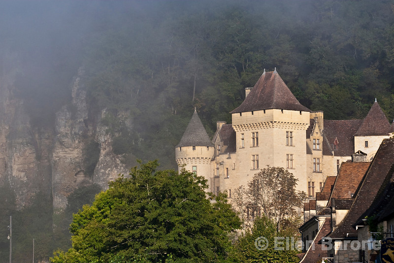 Morning mist shrouds a lovely chateau at la Roque Gageac, France.