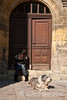 Street scene, woman and dog, Sarlat, France.