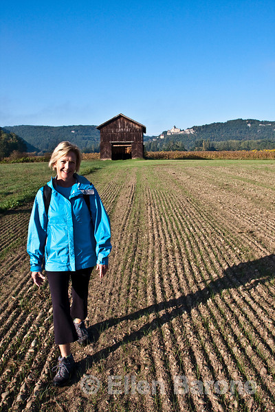 Wayfarer Judy Allpress with Castlenaud in the distance, near la Roque Gageac, Dordogne, France.