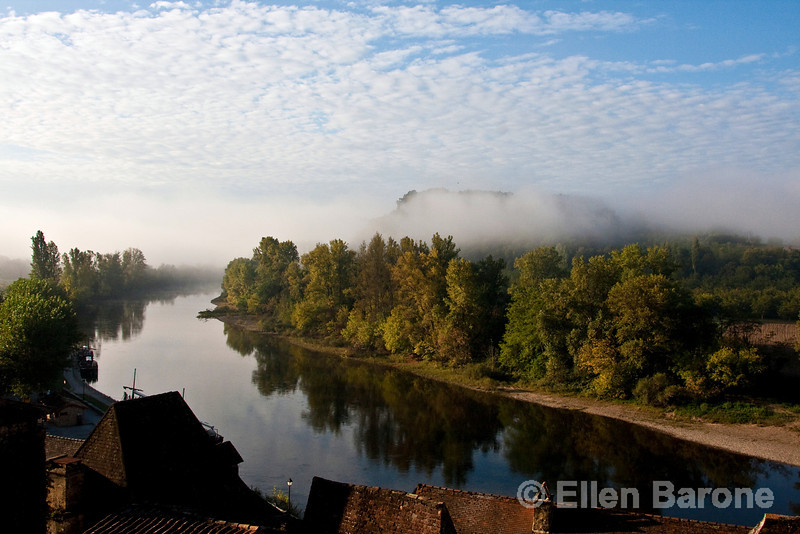 Morning mist and rooftops, Dordogne River, la Roque Gageac, France.