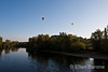 Ballons in flight over the Dordogne River, la Roque Gageac, France.