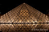 The Louvre pyramid at nighttime. Paris, France.
