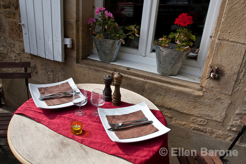 Cafe table, Restaurant la Flambee, Domme, France.
