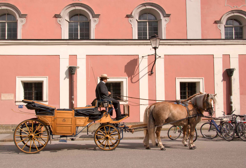 Elegant horse-drawn carriages are a comfortable and popular way to tour the lovely city of Salzburg, Austria, Europe.