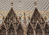 Zigzag tilework embellishes the roof of the Medieval church of Saint Stephan's (Stephansdom), Altstadt (Old City), Vienna, Austria, Europe.