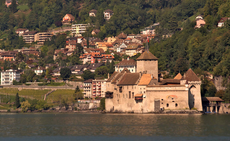 Chateau de Chillon and Montreux as viewed from Villeneuve, Lake Geneva, Switzerland, Europe.