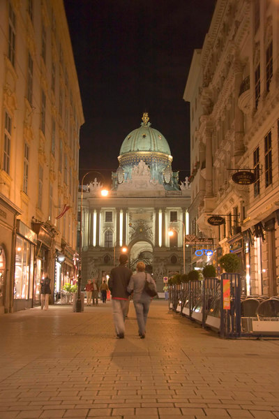 A view of the Hofburg Imperial Palace's grand entrance from Kohlmarkt, a stylish pedestrian shopping street, at night, Altstadt (Old City), Vienna (Wien), Austria, Europe.