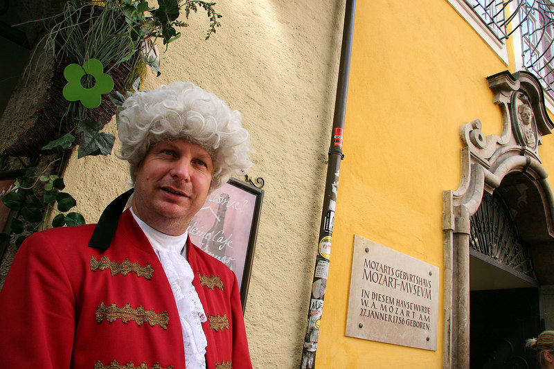 Costumed Mozart,  Peter Url, poses for photos in from of the Mozart Museum, Salzburg, Austria, Europe. Model Release #0048.
