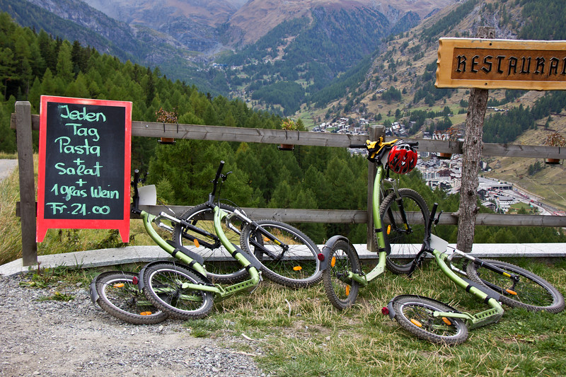Kick-bikes at rest where a wayside halt at one of the attractive restaurants is almost compulsory, Zermatt, Swtizerland.