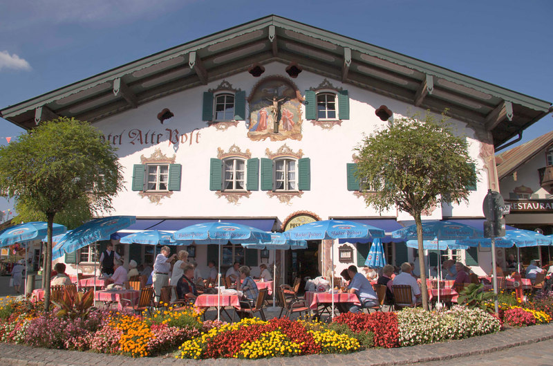 Storybook buildings and gardens abound in lovely Obergammergau, Bavaria, Germany, Europe.