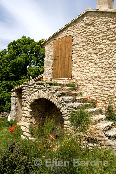 Picture perfect stone houses and lush gardens dot the landscape throughout the Luberon region of Provence, France, Europe.