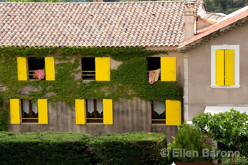 Colorful yellow shutters,Provence, France, Europe