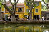 Colorful cafes surround the Etang, a rectangular pool of water surrounded by plane trees, in Cucuron,Provence, France, Europe