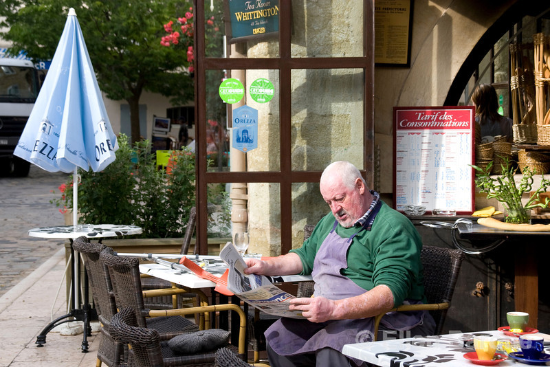 Passing the time with the news in Lourmarin,Provence, France, Europe