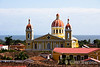 Red tile roofs, city Cathedral, Lake Nicaragua in the distance, Granada, Nicaragua.