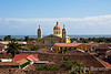Red tile roofs, church towers, Lake Nicaragua in the distance, Granada, Nicaragua.