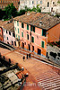colorful homes line the steep stairway that climb to the heart of the hilltop town of Perguia, Umbria's regional capital, Umbria, Italy