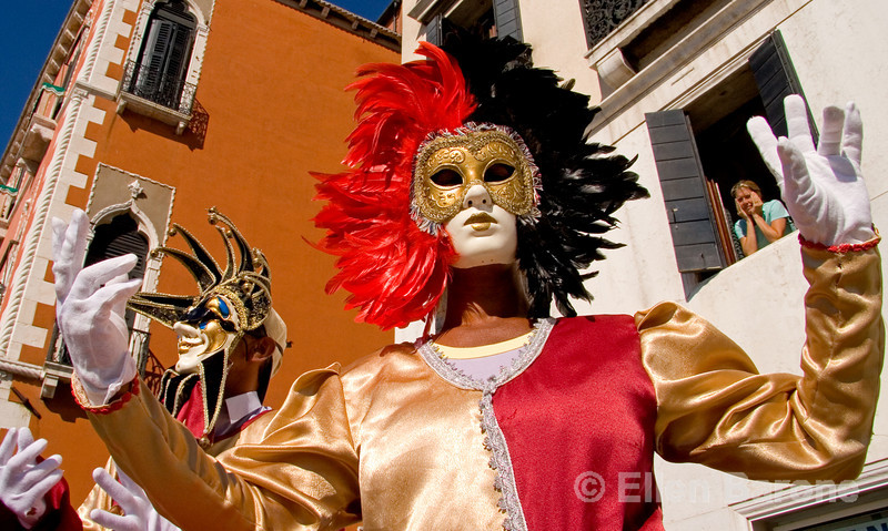 masked revelers greet visitors along the Riva degli Schiavoni, near St. Mark's Square, Venice, northern Italy
