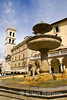 the lovely fountain-splashed Piazza del Comune and Tiempo di Minerva, Assisi, Umbria, Italy