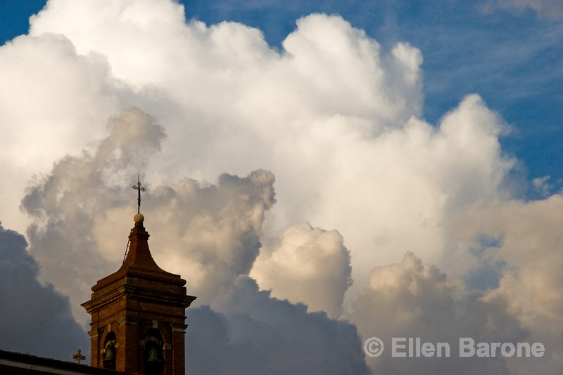 church steeple and dramatic clouds, Tuscany, Italy