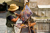 an artist paints a scene in lovely Assisi, Umbria, Italy