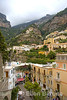 pastel painted houses cling to a vertiginous slope at Positano, Amalfi Coast, southern Italy