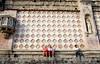 visitors rest against the striking facade of Perguia's Duomo, Perguia, Umbria, Italy
