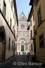 a narrow lane is flanked by the magnificent facade of Orvieto's Duomo, one of Italy's greatest cathedrals, Orvieto, Umbria, Italy