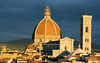 Rising above the heart of the city, the richly decorated Duomo - Santa Marie del Fiore - and its orange tiled dome are most beguiling in evening light, Florence (Firenze), Tuscany, Italy