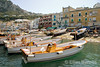 an array of colorful boats line the harbour at Marina Grande, the island's main port of call for ferries from Naples and other ports of call on the Tyrrhenian coast, Isle of Capri, southern Italy