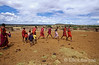 A group of young Masai boys attempts to join in with their elders in a traditional dance, Kenya, East Africa.