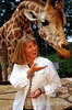 Micato Safari guest with giraffe