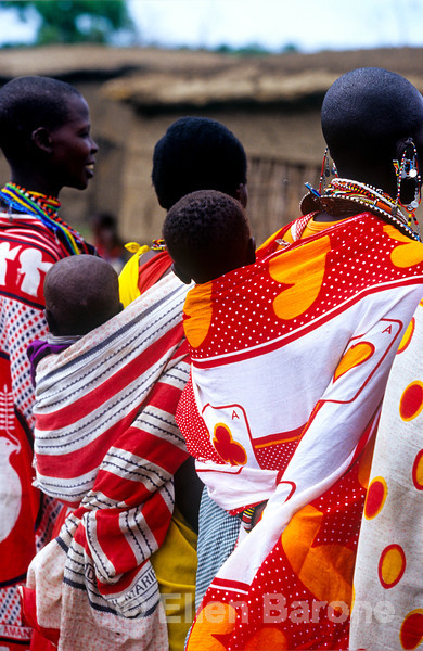 Samburu women carry their children in the traditional swaths of cloth, Kenya, East Africa
