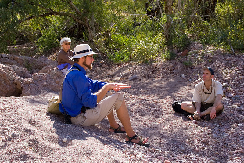 American Safari Cruises' expedition leader, Kevin Martin, relaxes with yacht passengers Mike Derzon and Irene Wicklund on Isla del Carmen, Sea of Cortez, Baja California Sur, Mexico.