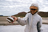 "Safari Quest passenger Irene Wicklund displays a salt-encrusted hard rock ""hamburger"" at the salt flats on Isla San Francisco, Sea of Cortez, Baja California Sur, Mexico."