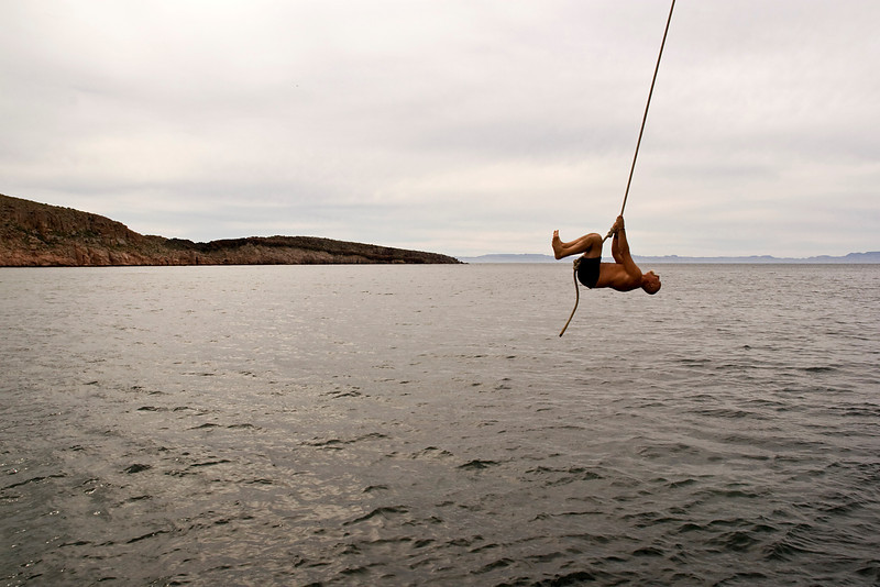 Captain Rod DuFour joins the fun in a rope swing off Safari Quest, Ensenada Grande, Isla la Partida, Sea of Cortez, Baja California Sur, Mexico.