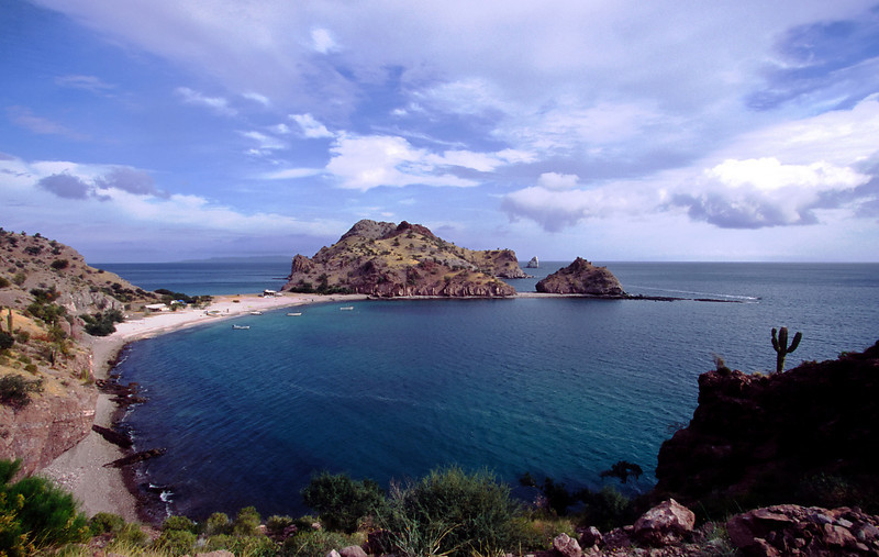 A blast of sunshine on an otherwise cloudy day renders Puerto Agua Verde one of the loveliest scenes imaginable, Sea of Cortez, Baja California Sur, Mexico.