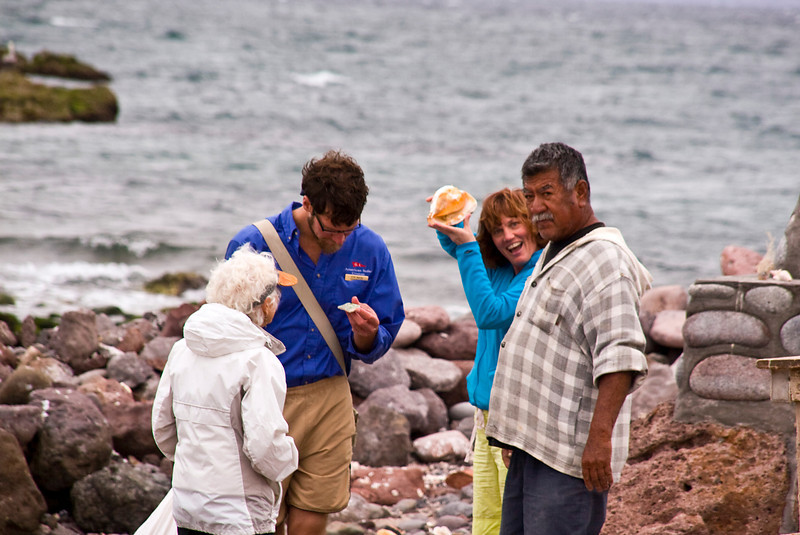 Safari Quest expedition leader, Kevin Martin, and passengers visit with a friendly fisherman on Isla Coyote, a lonely fishing outpost in the Sea of Cortez, Baja California Sur, Mexico.