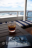 Kindle with rum drink, aft deck, Safari Quest, Sea of Cortez, Baja California, Mexico.