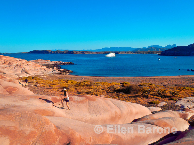 A scenic red sandstone playground at Puerto Los Gatos with Safari Quest in the distance, Sea of Cortez, Baja California, Mexico.