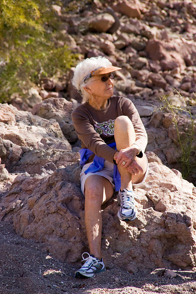American Safari Cruises passenger Irene Wicklun takes time out from a morning hike on Isla del Carmen, Sea of Cortez, Baja California Sur, Mexico.