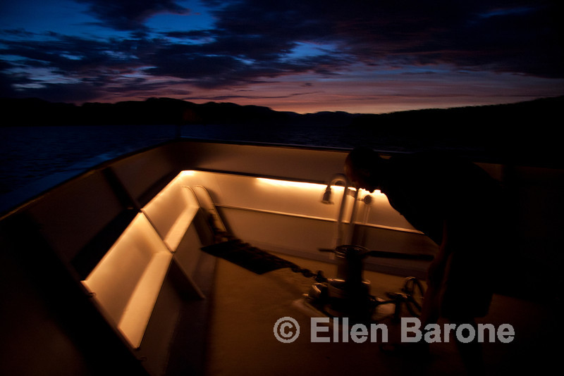 Safari Quest engineer, Dirk Boshchek, lowers the anchor beneath a magical Sea of Cortez sunset, Baja California, Mexico.