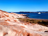 Safari Quest at anchor off the scenic red sandstone at Puerto Los Gatos, Sea of Cortez, Baja California, Mexico.